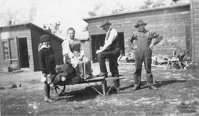 The Eugene A. Barlament family on their farm in Duck Creek on Velp Avenue. Mother, Lucinda, father, Eugene, son Harry and daughter Hattie.