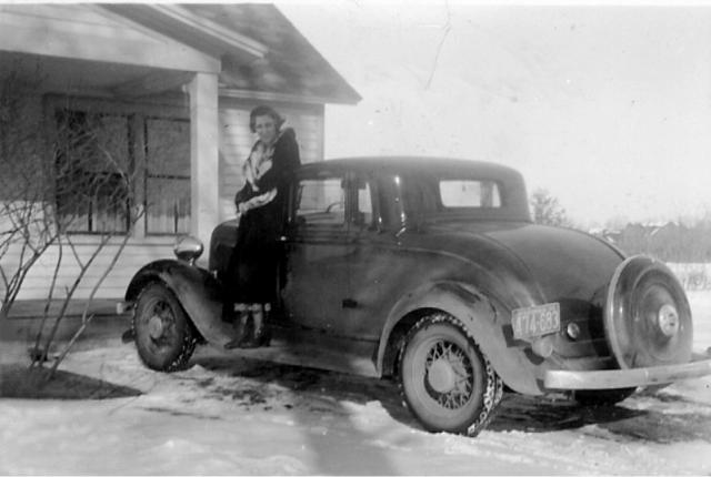 Minerva Johnston by her 1925 Plymouth automobile.